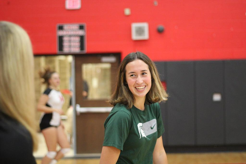 A smiling girl in a gymnasium