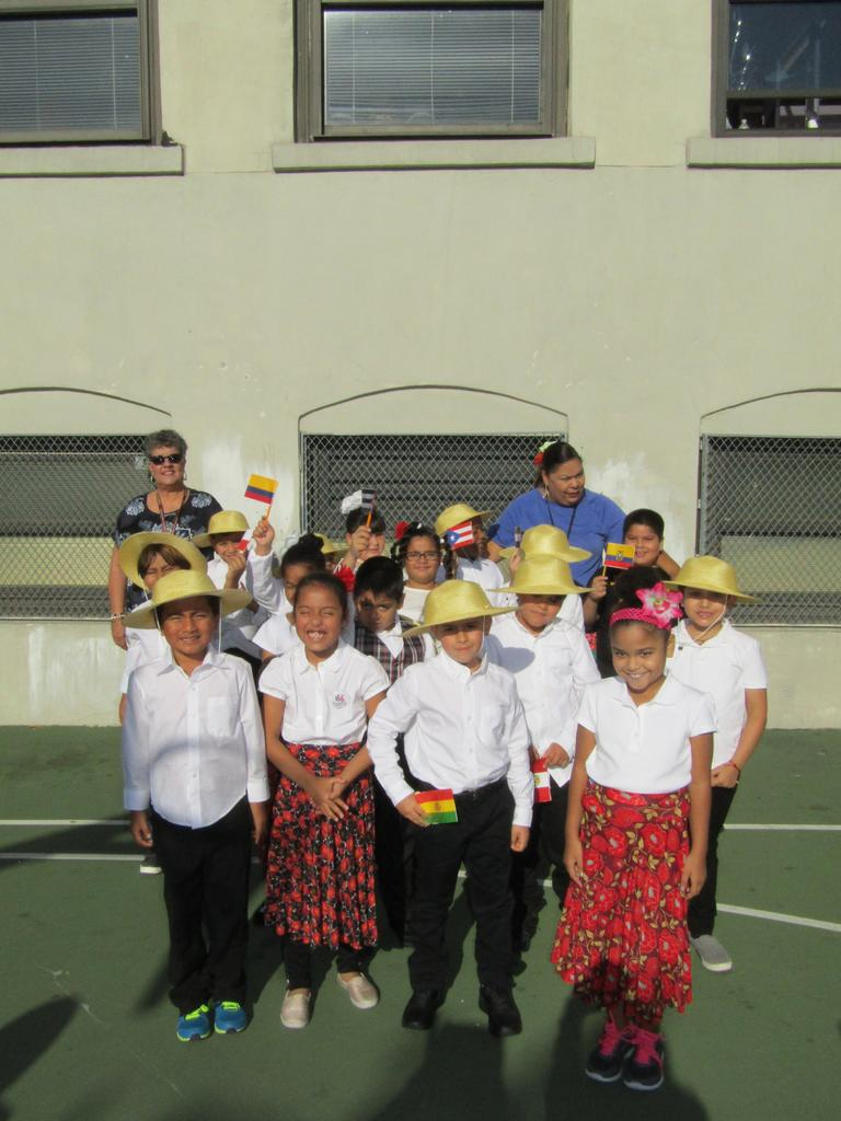 Mrs. Castillo with her class outside in their Hispanic Heritage outfits