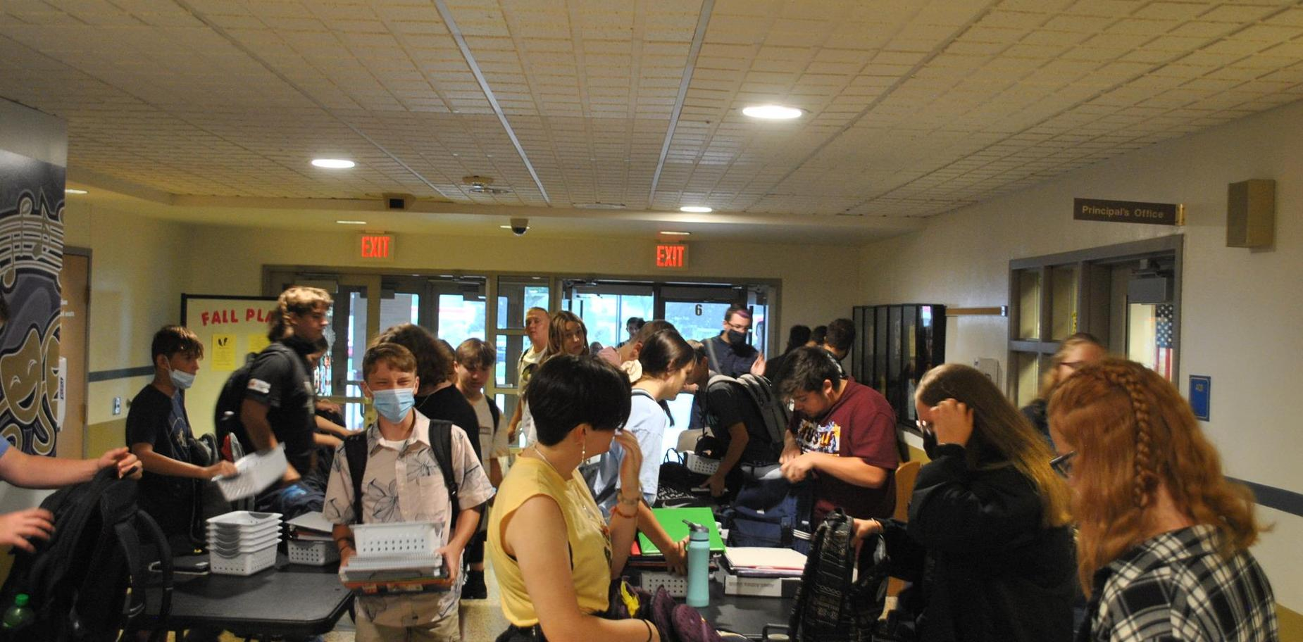 Students at metal detectors on first day of school