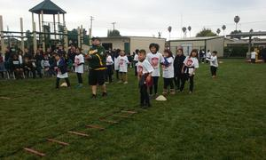 Students getting ready to runt he obstacle course.