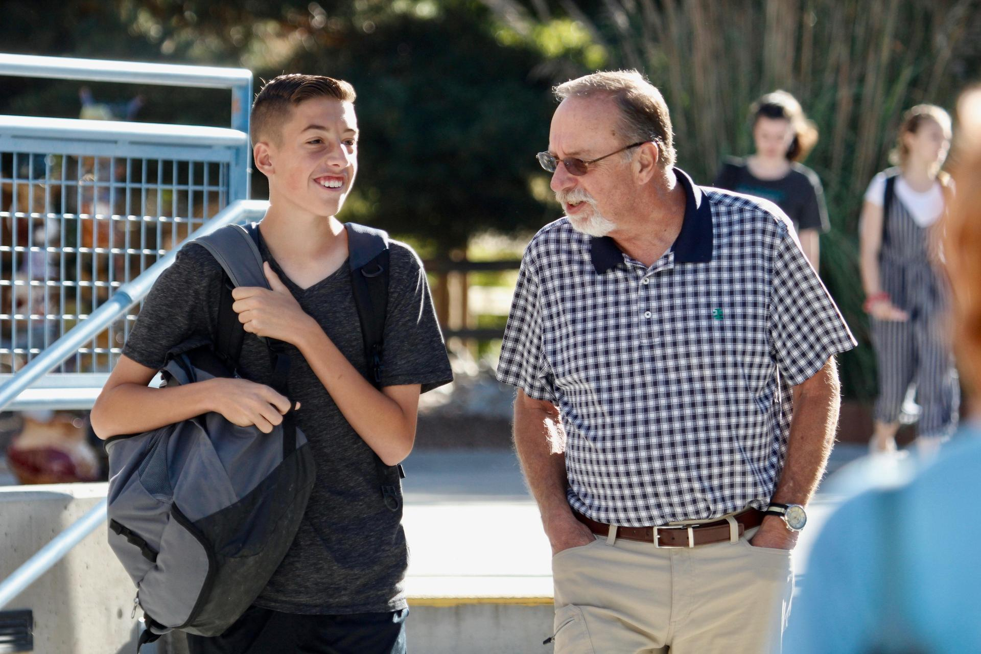 Student walks with grandparent