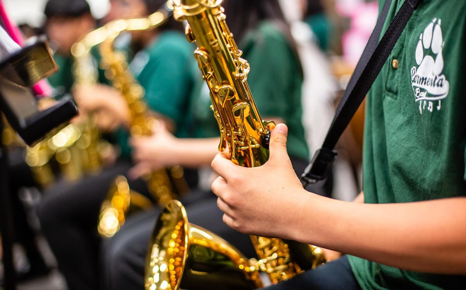 Close up of student playing saxophone.