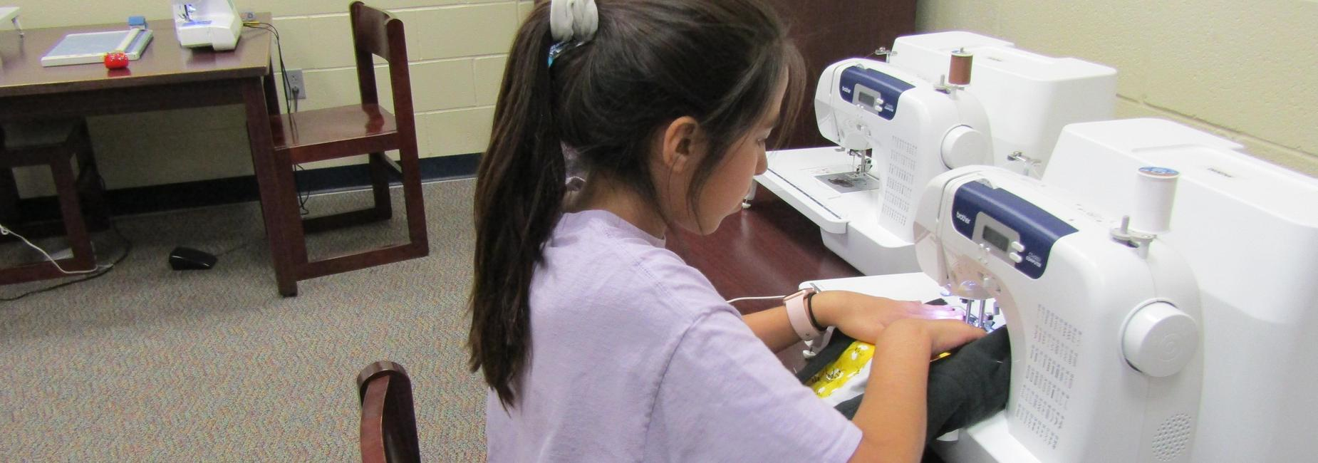 Student sewing.