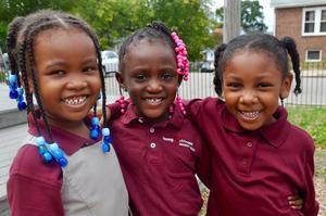 scholars smiling