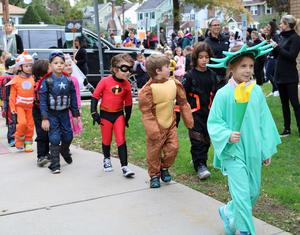 Kindergartners and preschoolers show off their costumes during Lincoln School Halloween Parade.