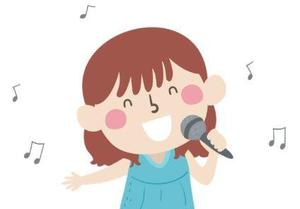 Little girl with brown hair and blue shirt singing into a microphone