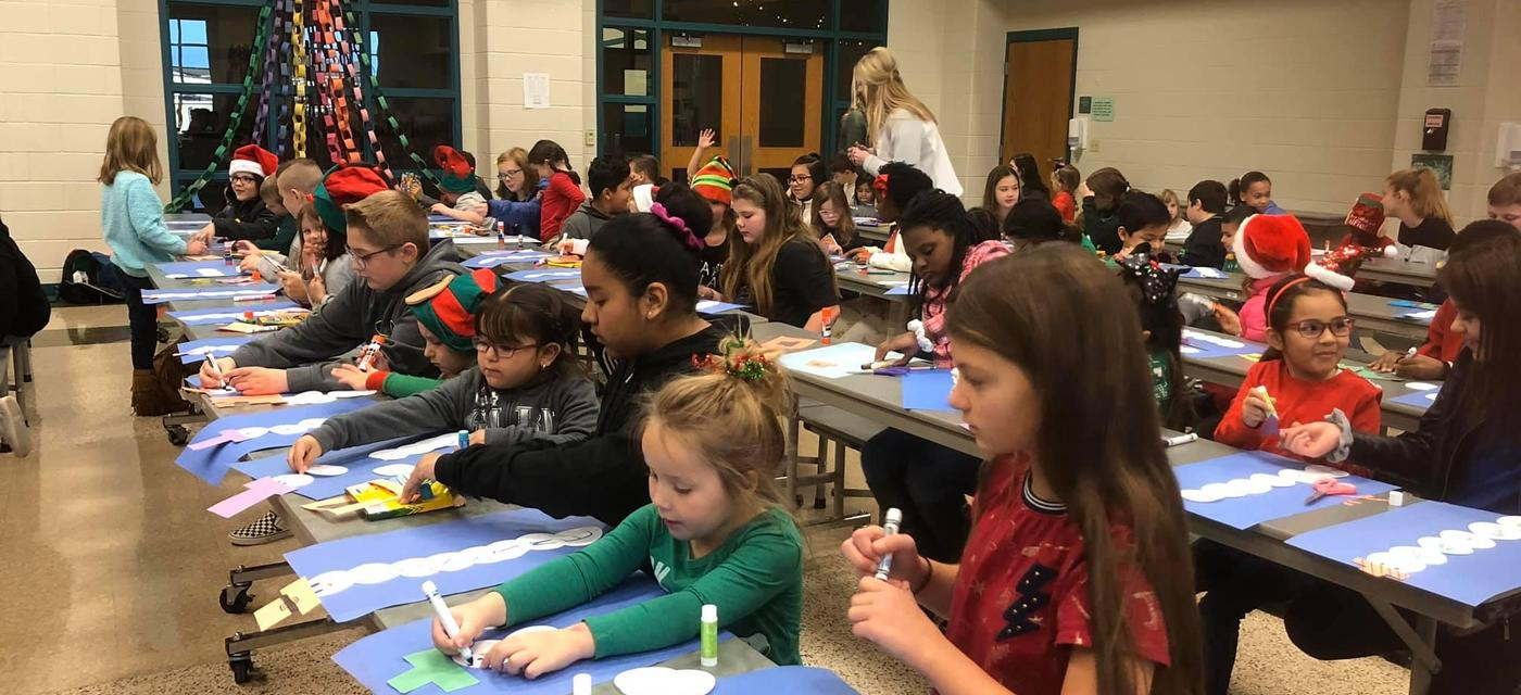 students making snowmen with construction paper