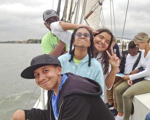A group of happy students returning to port after a busy afternoon.