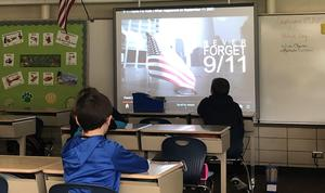 Students watch a movie on 9/11