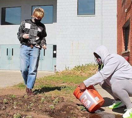Two students garden