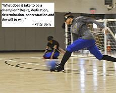 "Image of a student playing goalball: ""What does it take to be a champion? Desire, dedication, determination, concentration and the will to win."" - Patty Berg"