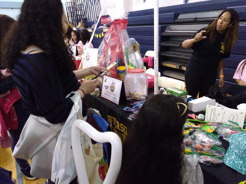 families buying stuff at Jefferson table