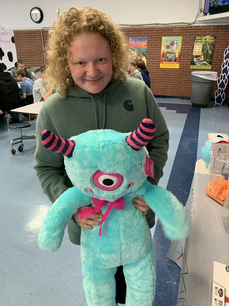 NMS students with stuffed monster.