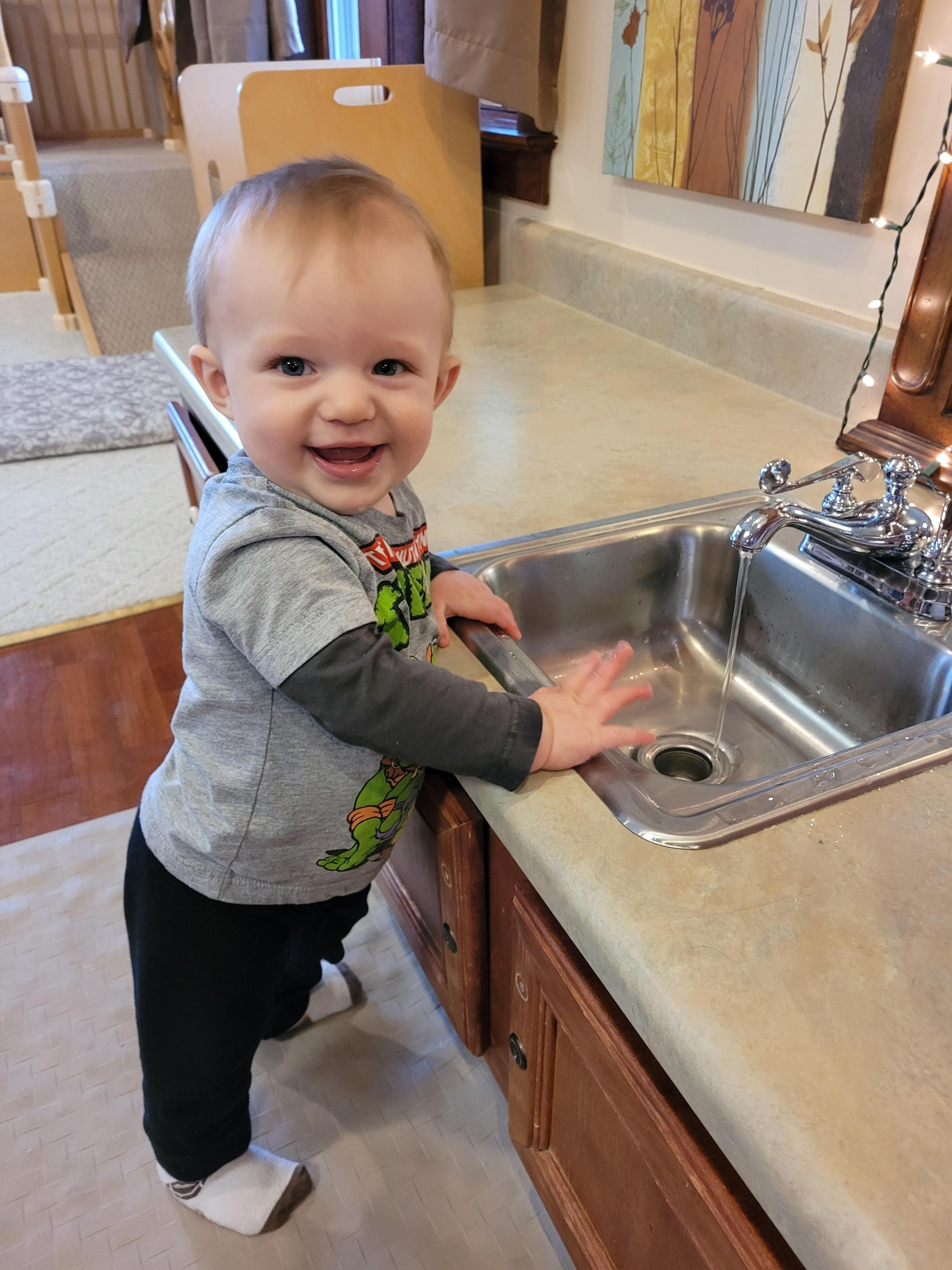 Baby at sink