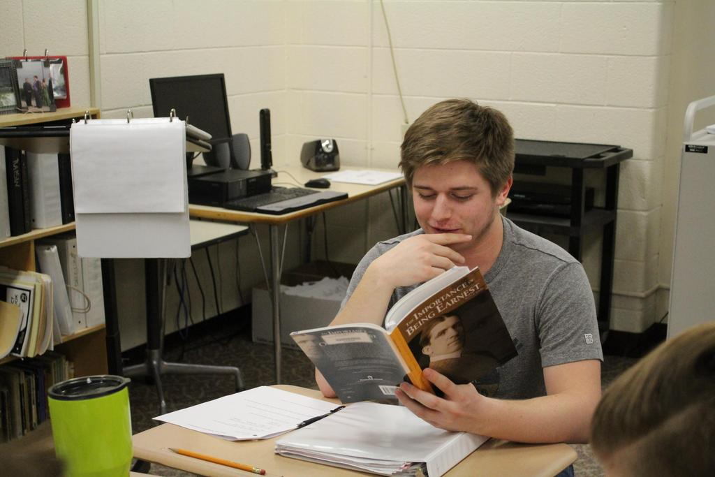 Student reading The Importance of Being Earnest