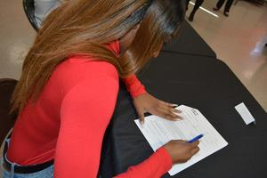 Dejah Outland signs her commitment letter for Lane College in Jackson, TN