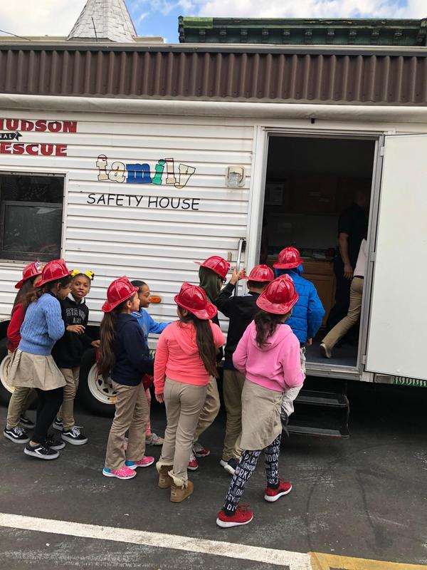 children entering the fire safety house