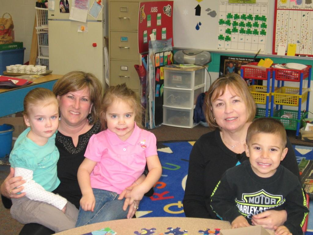 preschool teachers and students pose for camera