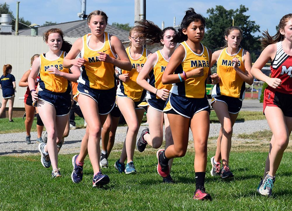 girls cross country runners