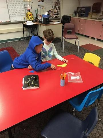 Students working with shapes.