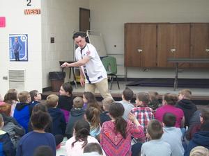 Hi-Toms talks with students.