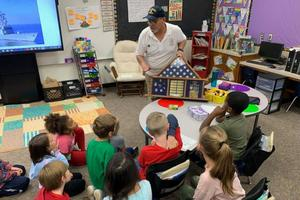 retired veteran joe lafuente talks about his 23 years of service to a group of crestview elementary students
