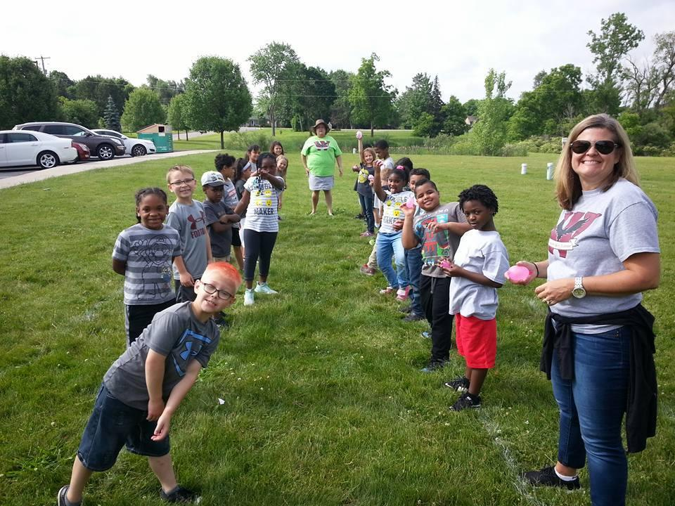 1st Graders having fun with water balloons on Field Day!