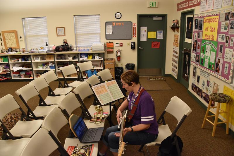 Teacher in her classroom teaching her students via Google Meet