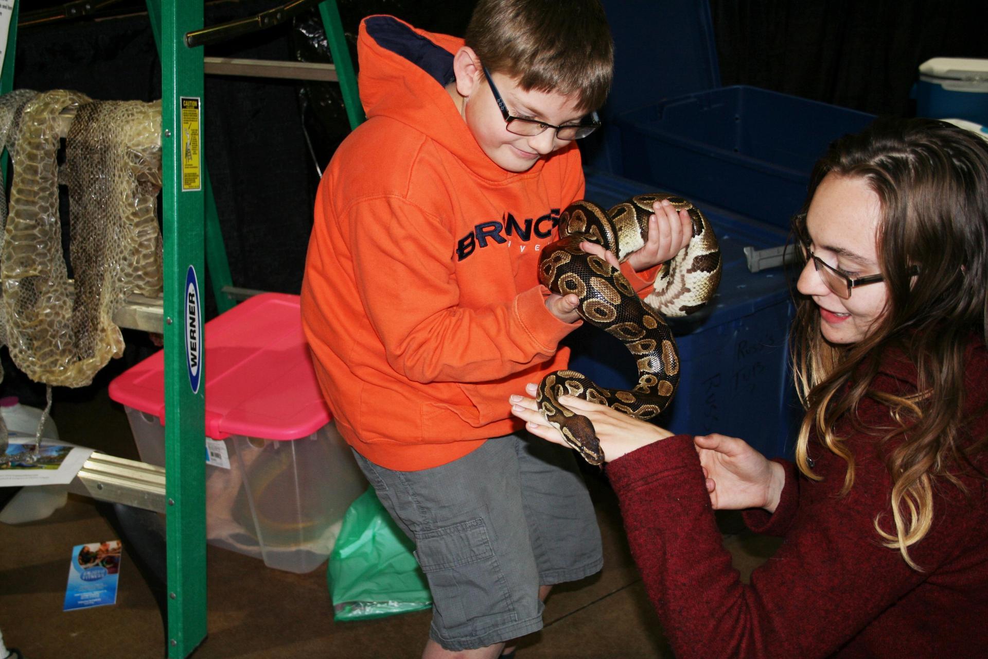 Boy holding a snake