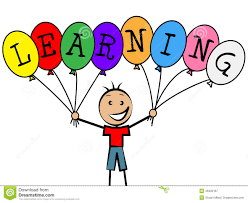 Child holding balloons that spell