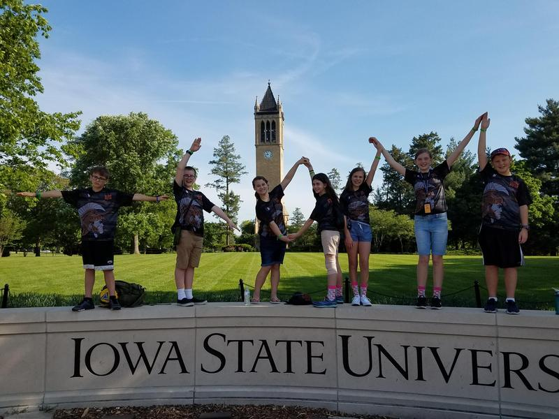 TKMS students spell out TK OM at the world finals in Iowa.