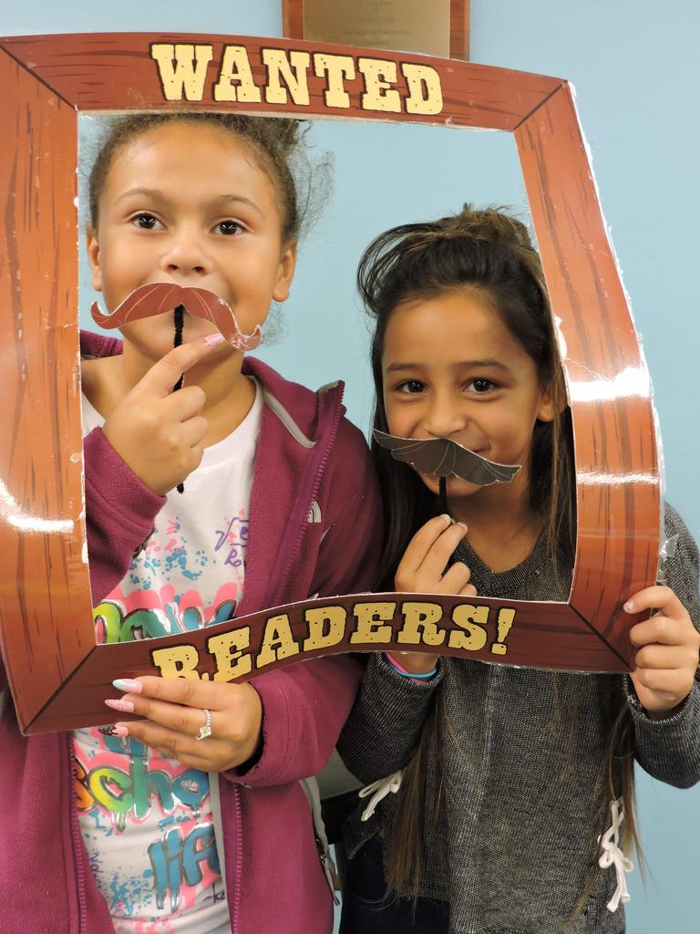 Students with Wanted Readers picture frame