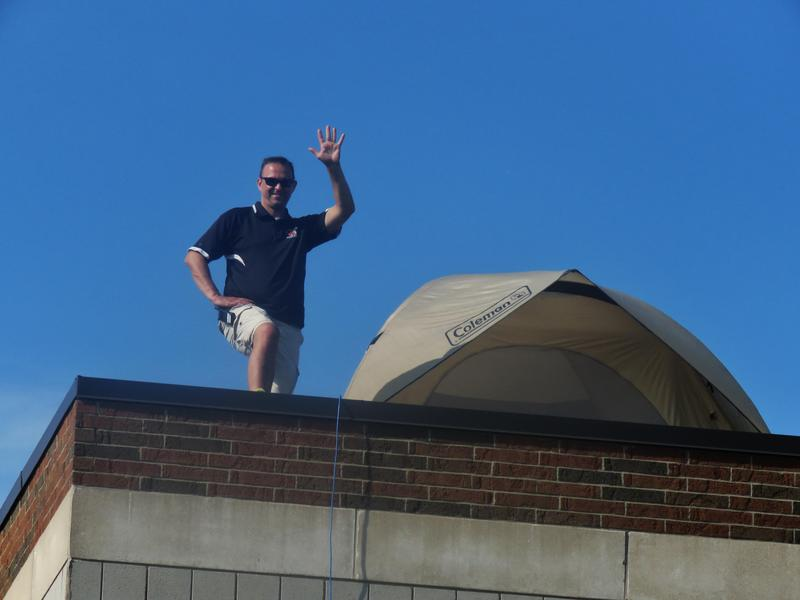 Gelmi camped out on the roof of the school for one year's celebration of reading.