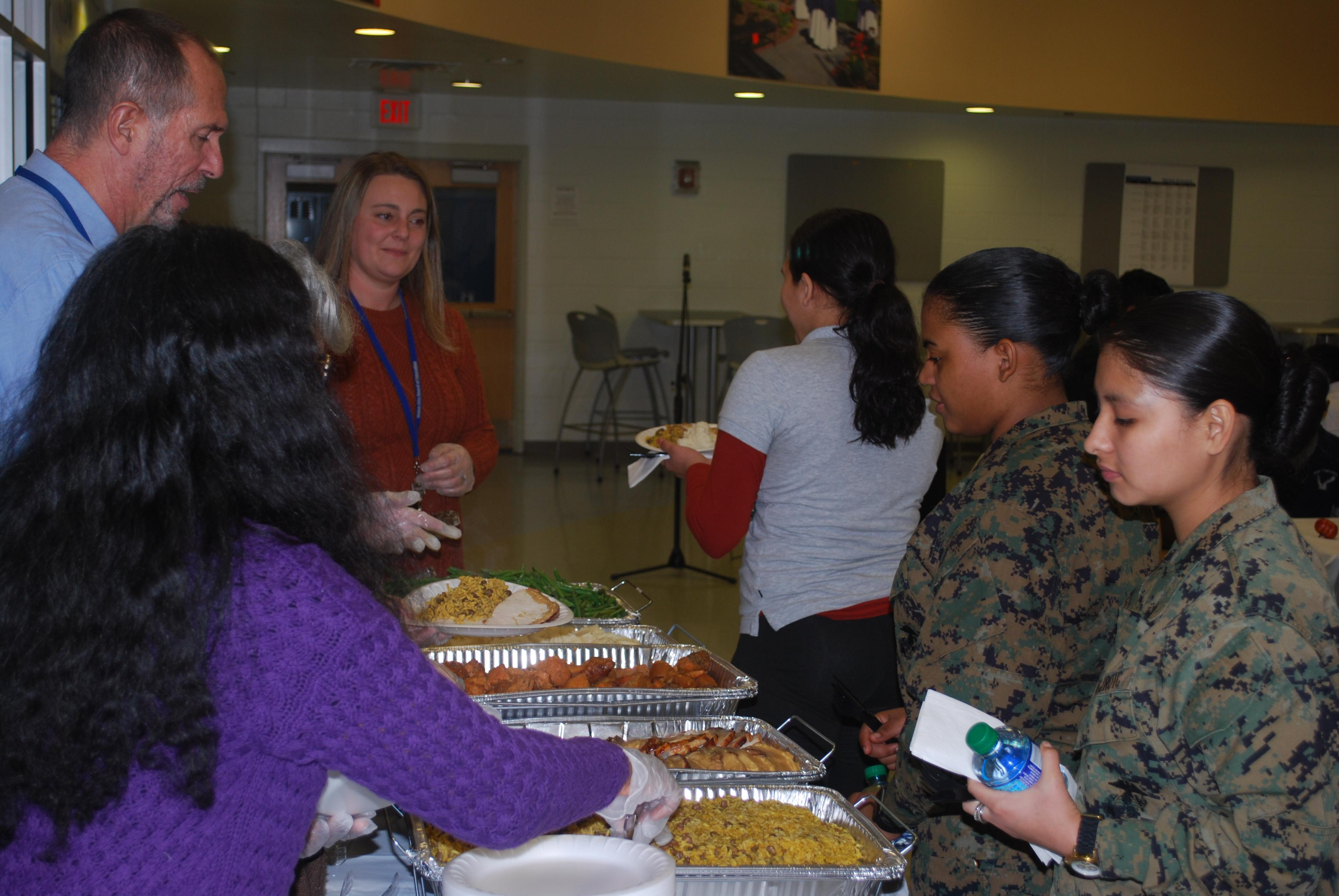 students being served a thanksgiving meal
