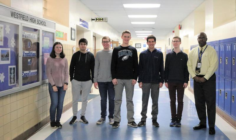 Six  Westfield High School students recently achieved the highest score possible on portions of SAT and ACT standardized tests.  The 6 perfect scorers are pictured here with WHS principal Dr. Derrick Nelson.
