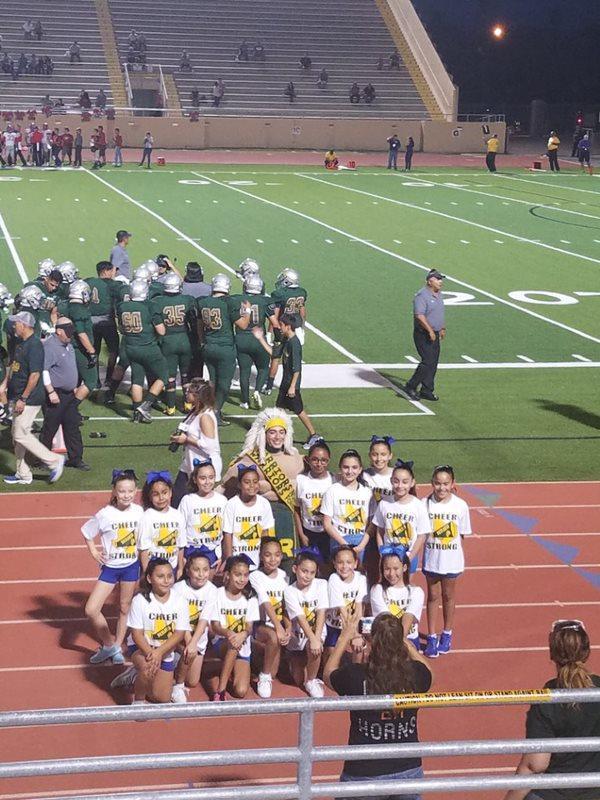 cheerleaders posing in game.