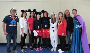 Photo of RIS staff dressed as Disney characters for Halloween.