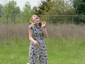 A Page student looks to the sky to track the path of her rocket.