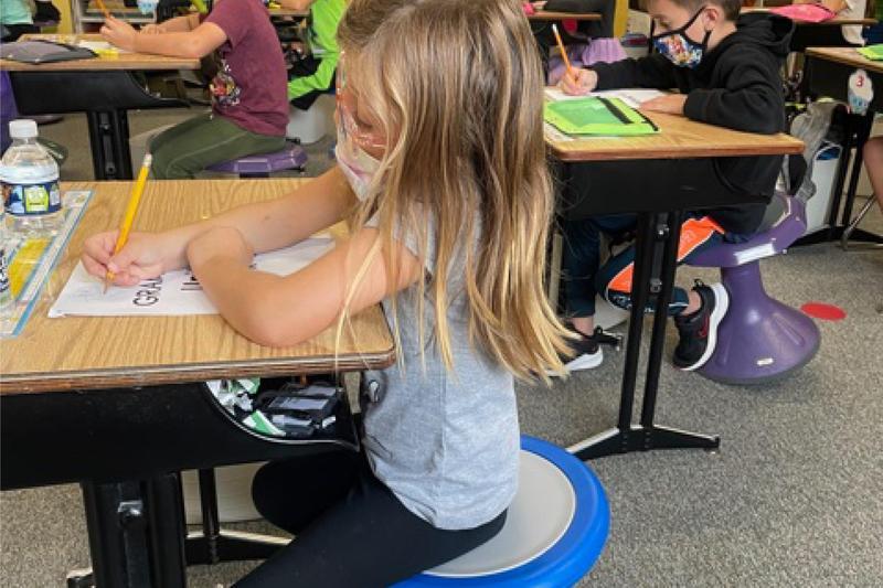 students on wobble stools