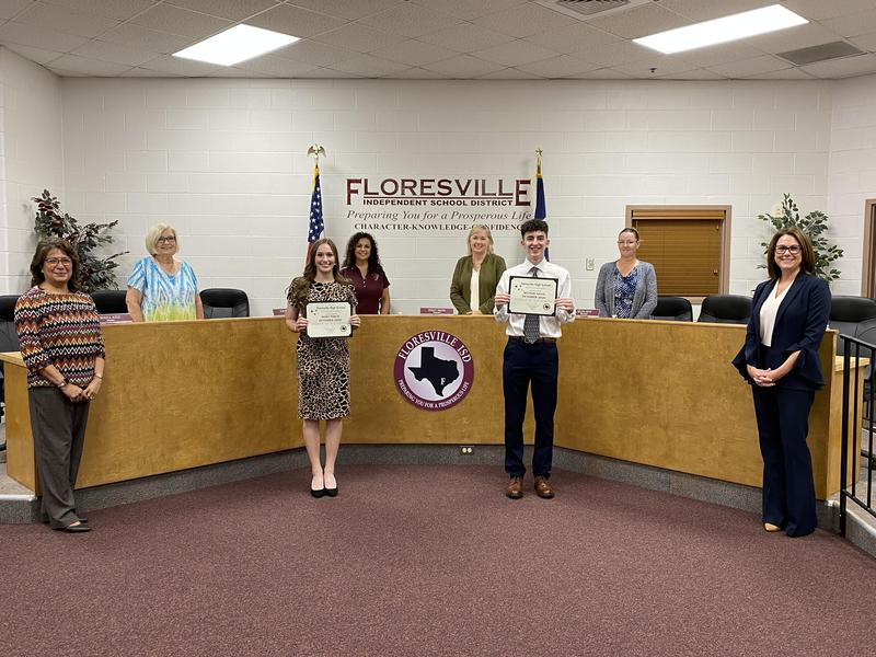 October Students of the Month standing, social distanced with Board members and administration.