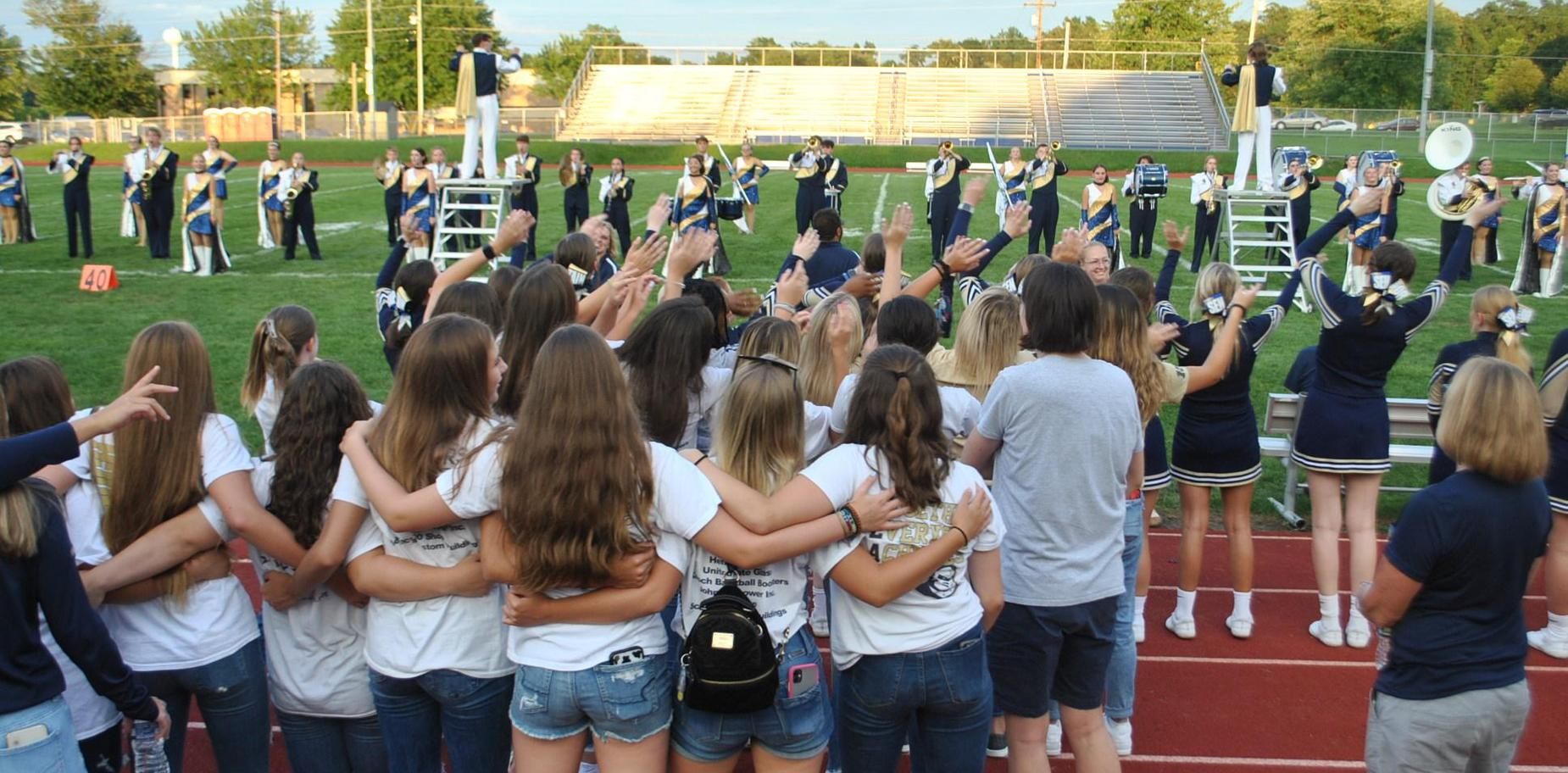 Students singing Alma Mater at Pie Night