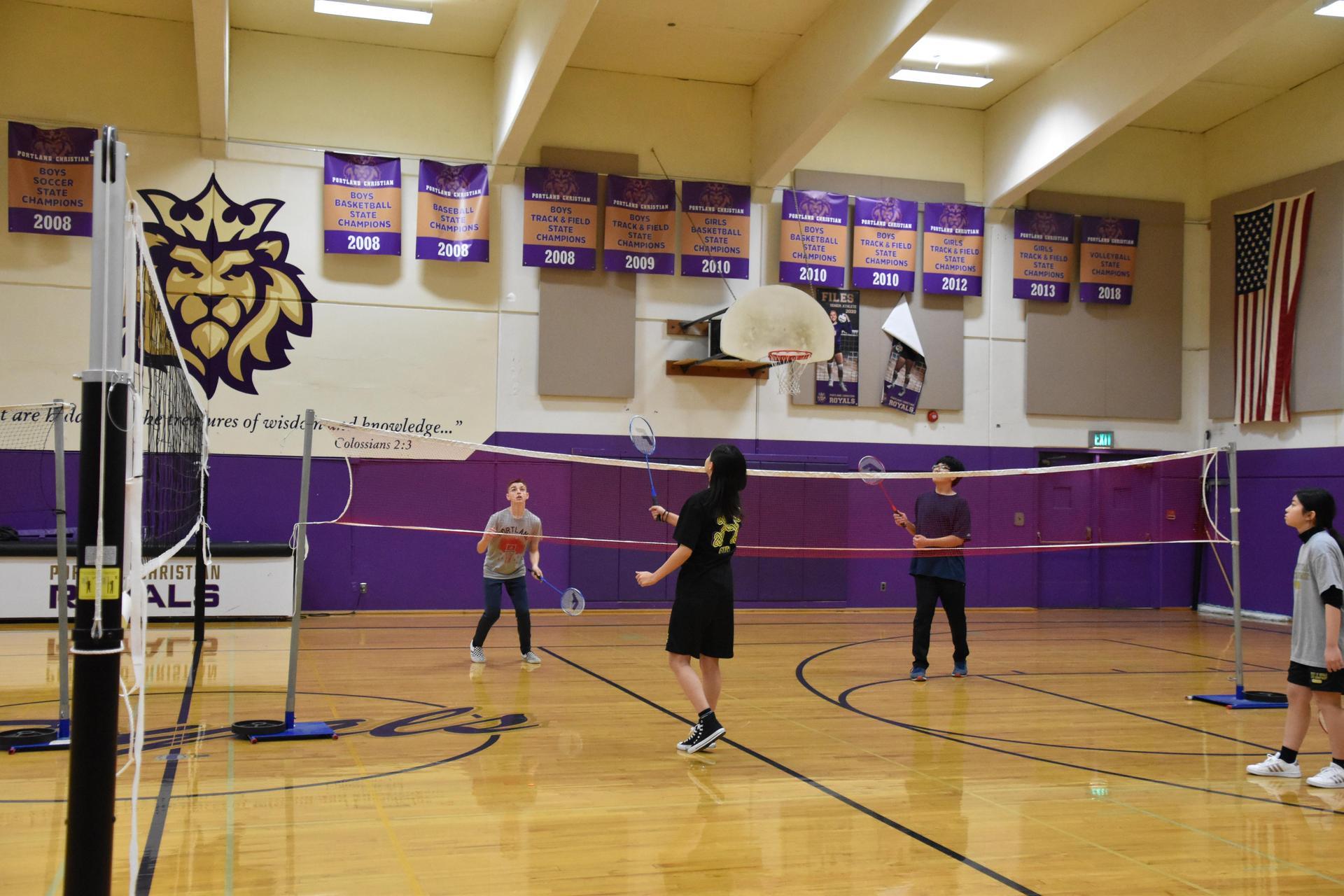 Playing badminton four ways
