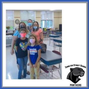 A family at Charlton Street Elementary School's open house event