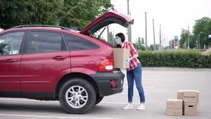 loading boxes into car
