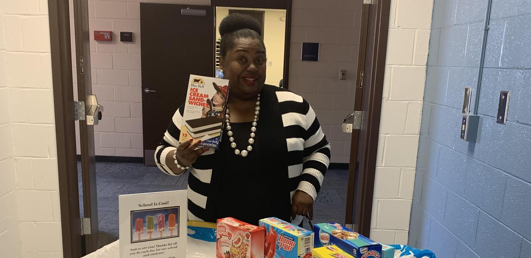 Dr. Tindal delivering sweet treats to staff during American Education Week