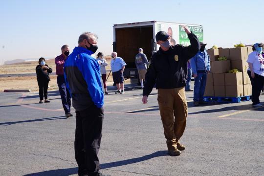 Roy Bassett handing out food