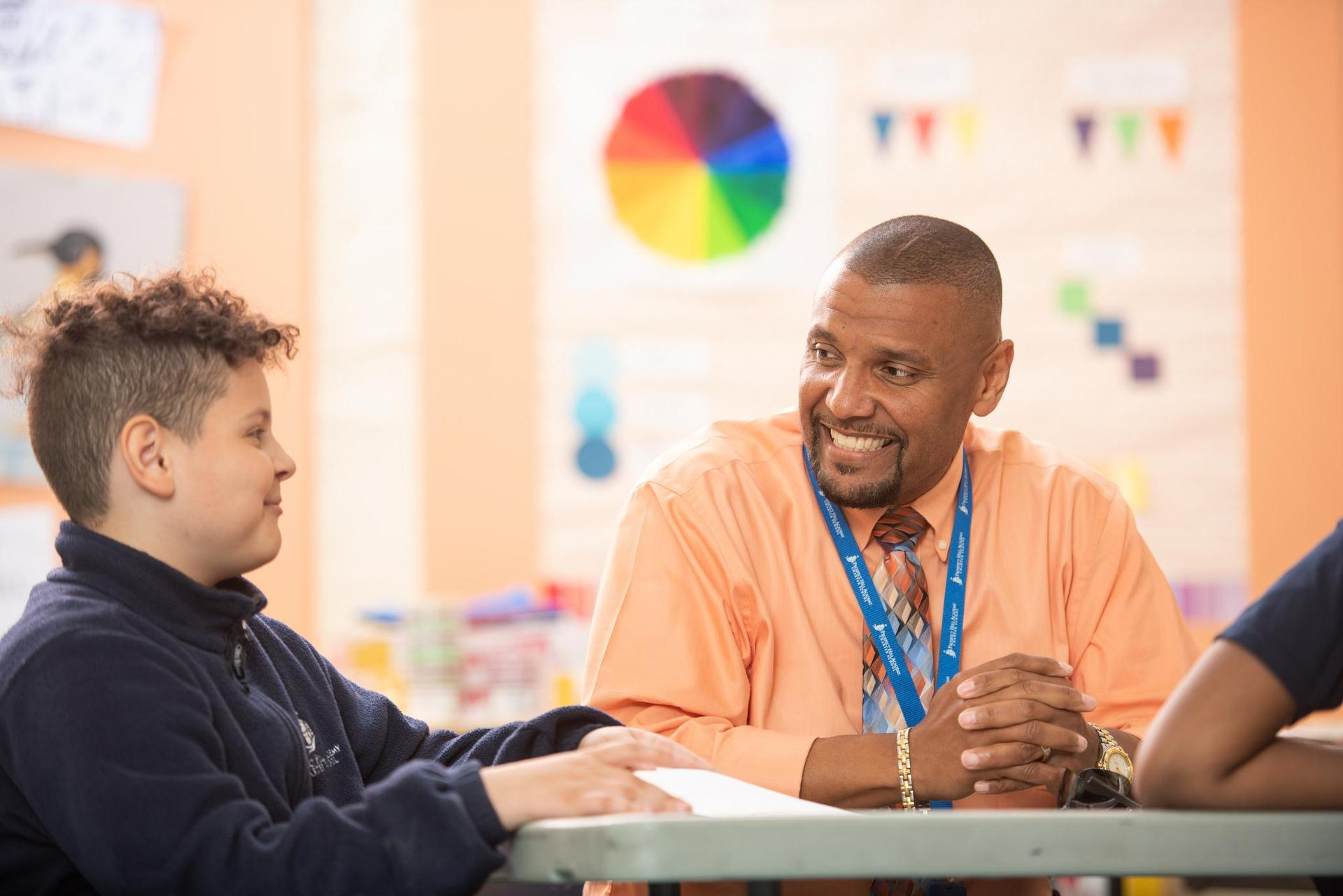 The Upper Elementary principal with a student.