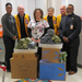 Lions Club members with school nurse