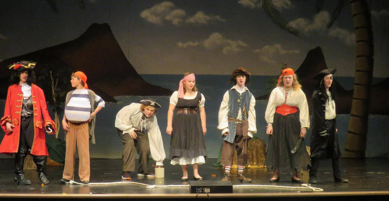 Students portray a band of pirates in