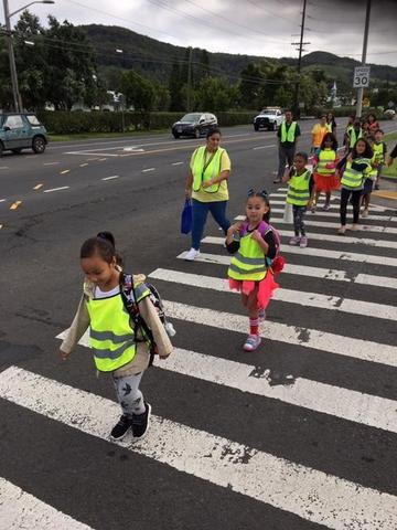 children crossing crosswalk